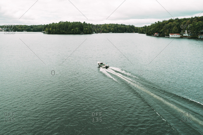 High angle view of motorboat on Lake Rosseau against sky