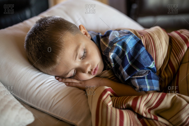 High angle view of boy sleeping at home