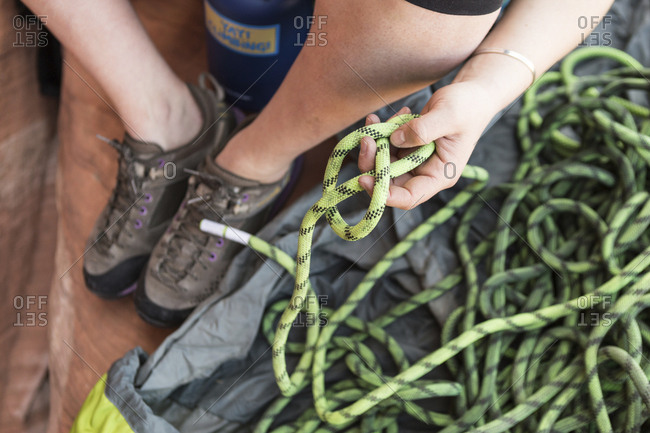 Low section of woman holding rope