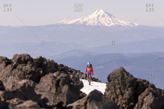Woman hiking against snowcapped mountain during winter