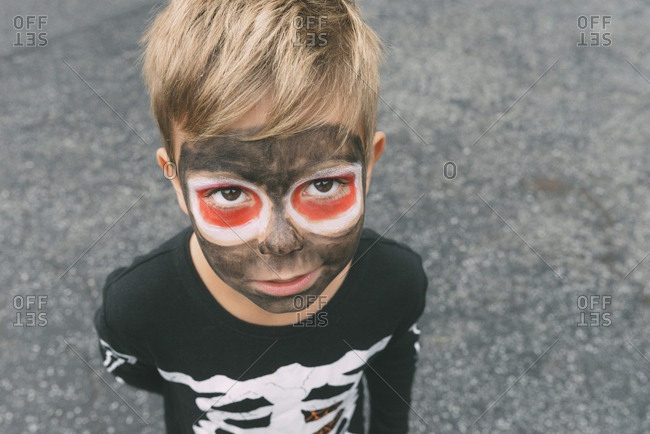 High angle portrait of boy with face paint during Halloween