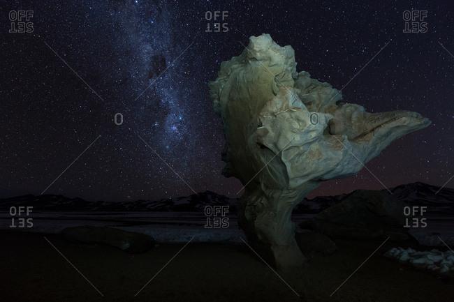 Arbol de Piedra rock formation formed by wind erosion under a starry night.