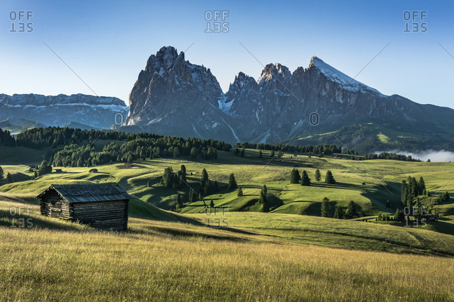 Rolling hills with chalets in the Dolomites region in South Tryol, Italy