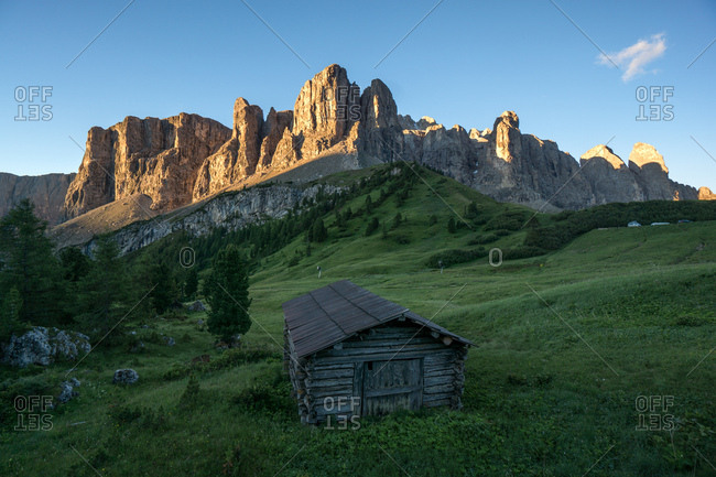 Gardena Pass and a chalet in the Dolomites region in South Tyrol, Italy