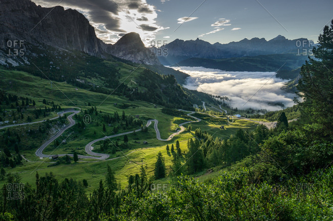 Winding road near Gardena Pass in the Dolomites region in South Tyrol, Italy