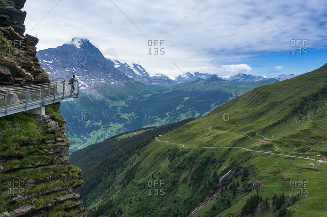 Man overlooking mountains in Grindelwald, Switzerland