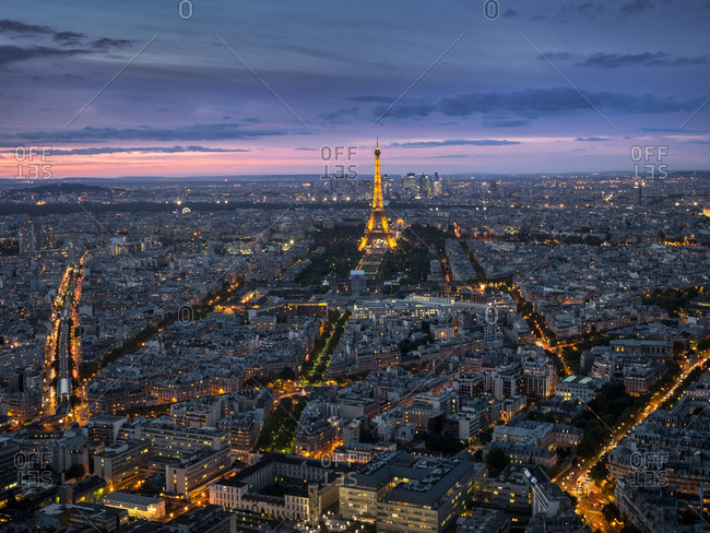 Paris, France - October 3, 2017: The city of Paris with the Eiffel Tower illuminated at sunset