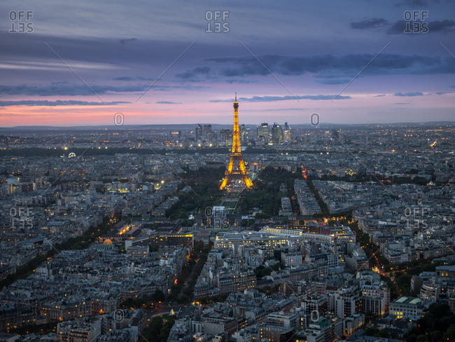 Paris, France - October 3, 2017: The city of Paris with the Eiffel Tower illuminated at sundown