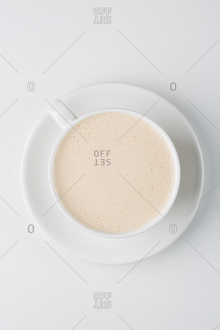 Overhead view of a foamy cappuccino