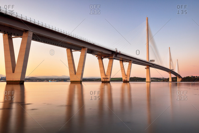 The Queensferry Crossing Bridge over the Firth of Forth estuary at Sunset