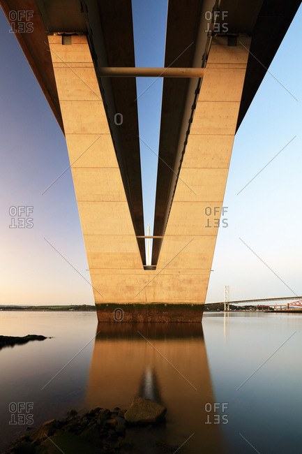 A view from beneath the new Queensferry crossing bridge reflecting on the Firth of Forth