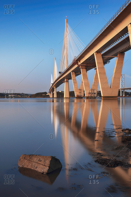 The new Queensferry crossing bridge reflecting on the Firth of Forth, South Queensferry, Edinburgh