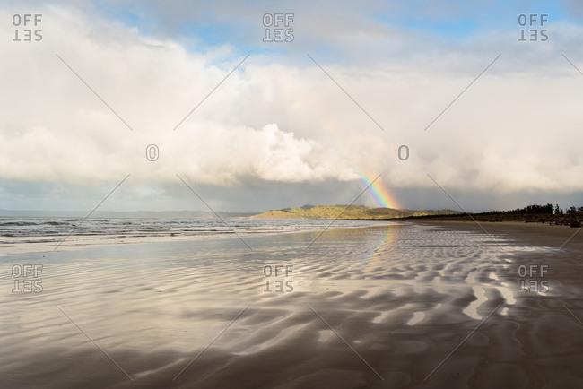 Rainbow over the beach in Hawke's Bay, New Zealand