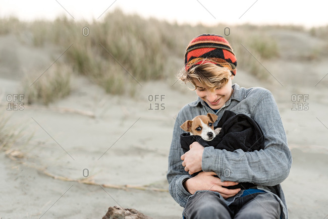 Boy swaddles puppy