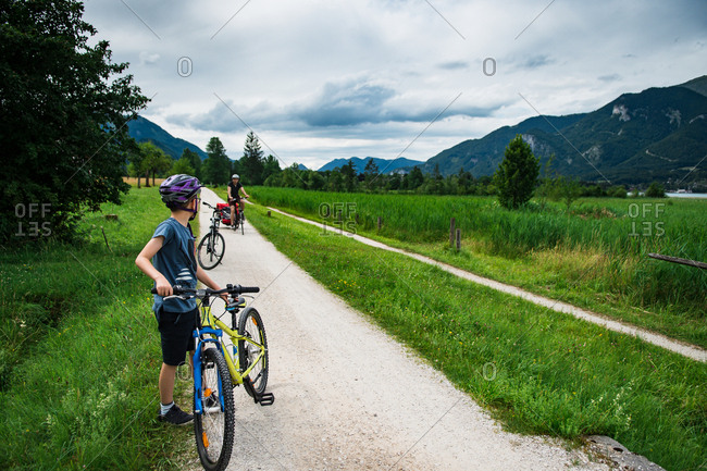 Boy with a bike on a cycling lane in the Alps in Austria
