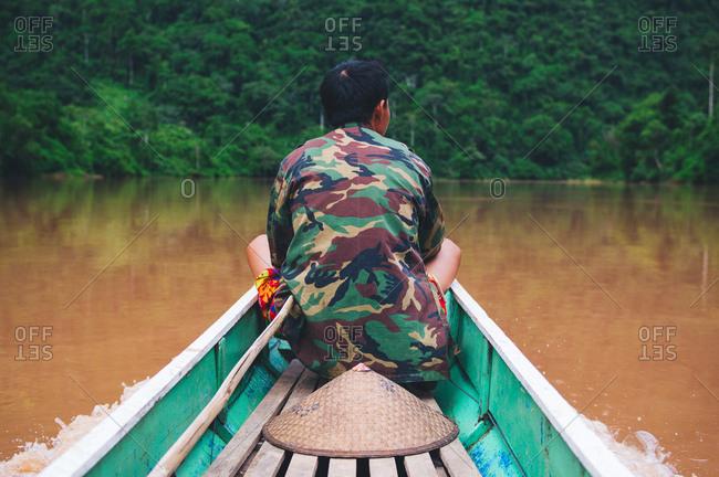 Man in canoe in camo jacket