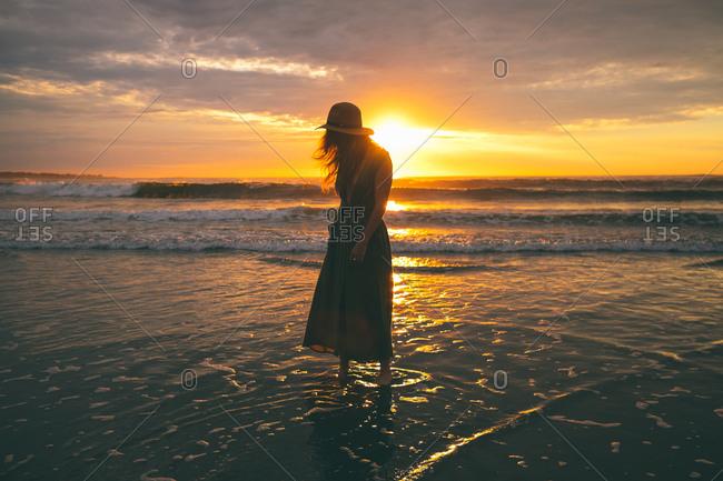 Woman in dusky ocean setting
