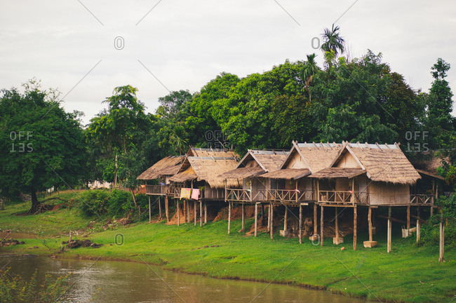 Elevated shacks by a river