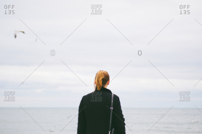 Woman from behind at seashore