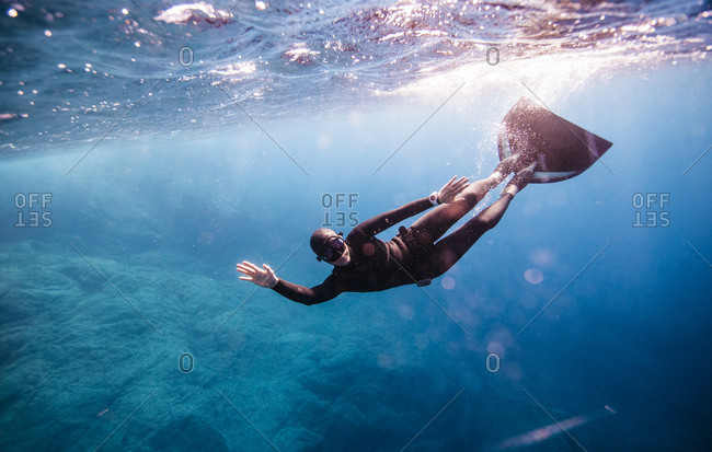 A free diver swims in the Mediterranean