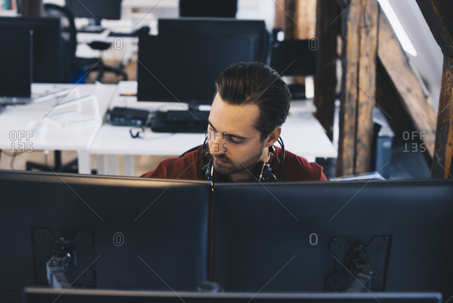 Businessman working on computers at office