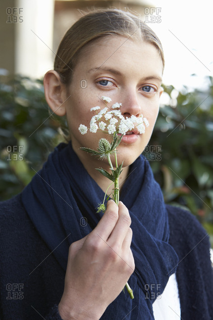 LONDON - 18 SEPTEMBER, 2017: Portrait of fashion model Alley Ertel standing in the street holding a flower, Day 4, London Fashion Week.
