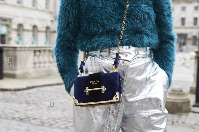 LONDON - 15 SEPTEMBER, 2017: Mid section detail of woman wearing Prada clothes and handbag standing outside Somerset House, Day 1, London Fashion Week.
