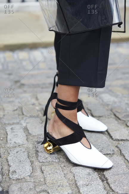 LONDON - 15 SEPTEMBER, 2017: Low section of woman standing outside Somerset House wearing black crop trousers and JW Anderson cylinder heel pumps, Day 1, London Fashion Week. Day 1, London Fashion Week.