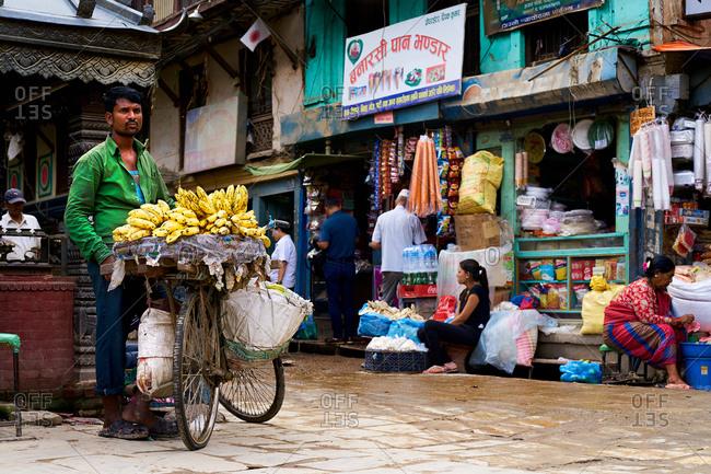 Thamel District, Kathmandu, Nepal - July 30, 2017: Man selling bananas on the streets