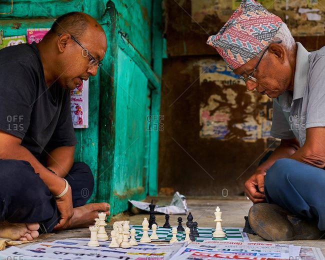 Thamel District, Kathmandu, Nepal - July 30, 2017: Two men playing Chess