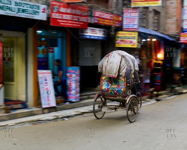 Pedal rickshaw passing in Kathmandu, Nepal