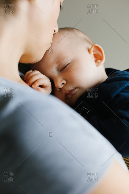 Mother kissing her sleeping baby