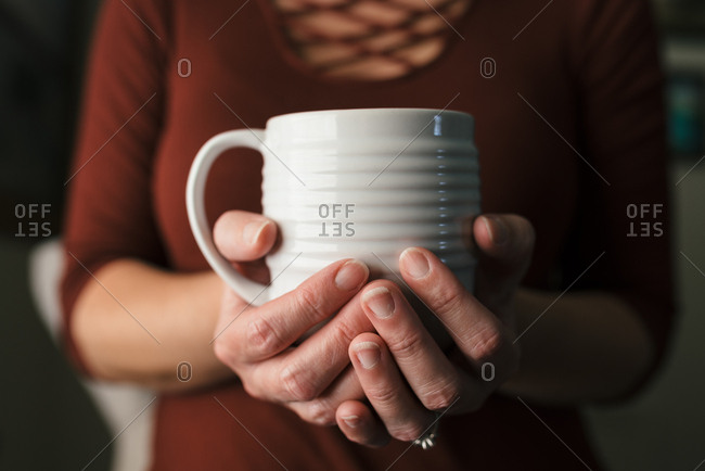 Person a white coffee cup