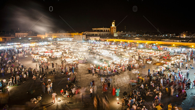 Marrakesh, Morocco - July 22, 2013: The lights and the life of the Jemaa El Fna, the main square, Al-Magreb