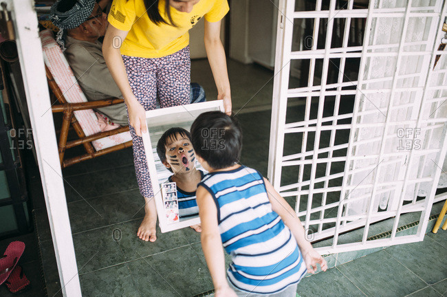 Young child in face paint looking at reflection