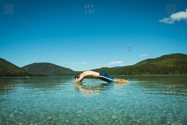 Man swimming in river on a sunny day