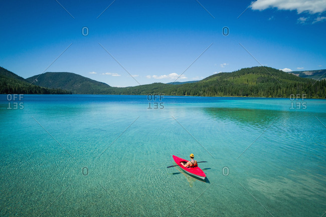 Man kayaking in lake on a sunny day