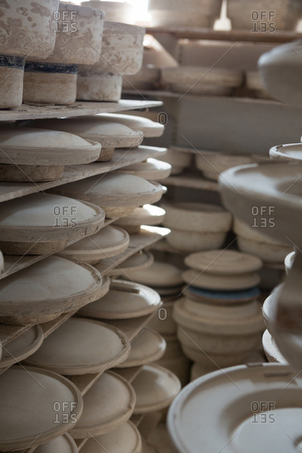 Earthen pots kept in shelf at pottery workshop