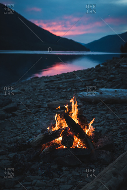 Campfire near lakeside at night