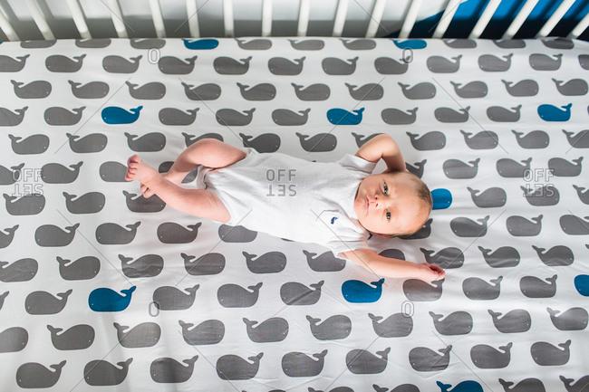 Newborn baby laying in a crib