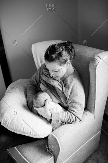 Mother breastfeeding newborn baby