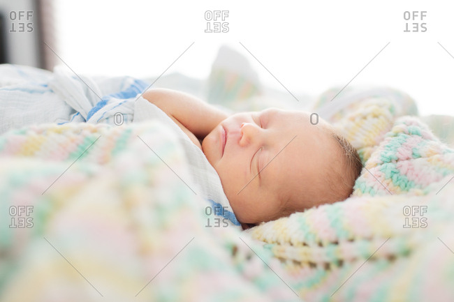 Profile view of newborn baby sleeping