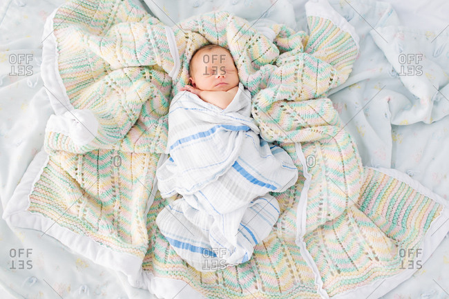 Newborn baby wrapped in blankets