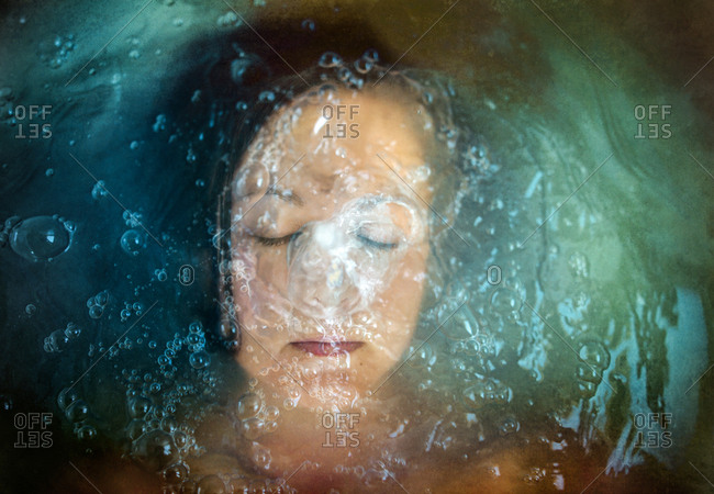 Woman submerged in bath
