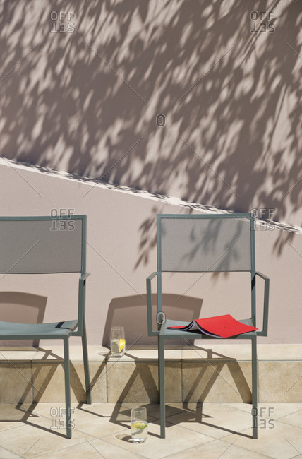 Villa terrace with chairs and lemon waters, Theoule sur Mer