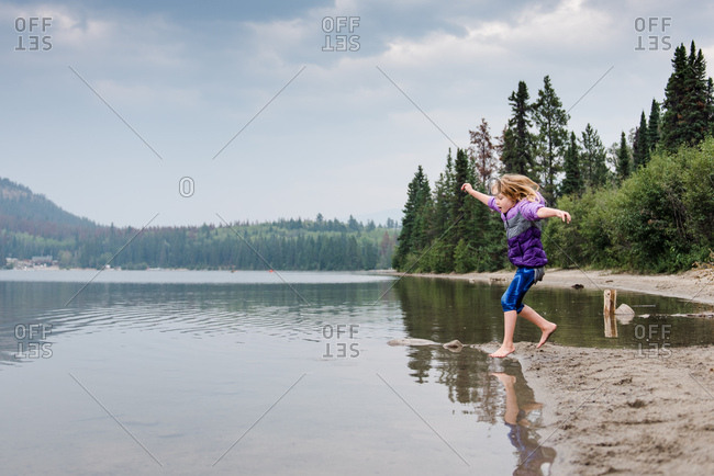 Girl runs into lake, Jasper National Park