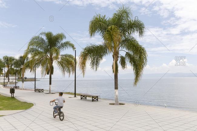 Ajijic, Mexico - July 13, 2016: Boy rides a bicycle