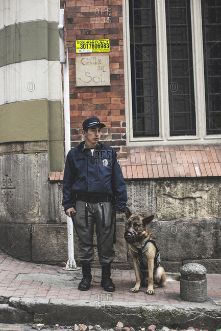 Bogota, Colombia - May 3, 2016: A police man with his dog on duty