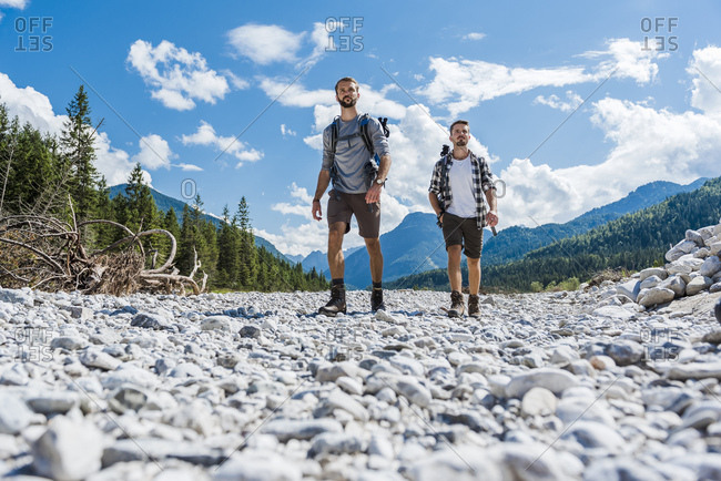 Germany- Bavaria- two hikers walking in dry creek bed