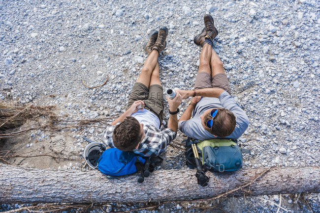 Two hikers having a rest- top view